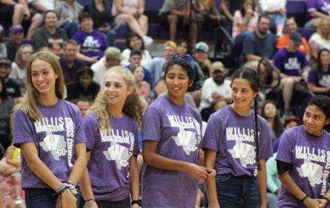 RECOGNIZED. Representing the  cross country team, seniors Sloane Veronico and Cori Teer with juniors Juliana Garcia, Juliana Needham and Jennifer Garcia are introduced during Meet the Kats. Football, volleyball, band, color guard, trainers, Sweethearts, cheer and ROTC participate in the community pep rally.