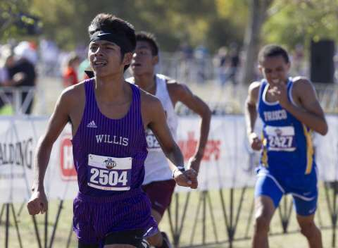 FINISHING STRONG. Giving it his all at Old Settlers Park in Round Rock at the UIL State Cross Country Meet, senior Carlos Barcenas works for a strong finish.  He broke his PR at the meet and finished in the top 20. When I run, I focus on the person in front of me, rather than the time, he said