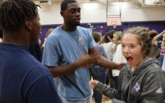 During a get-to-know-you activity at a FCA meeting, freshman Lucy Smith laughs at senior JaCoby McCoy's response.