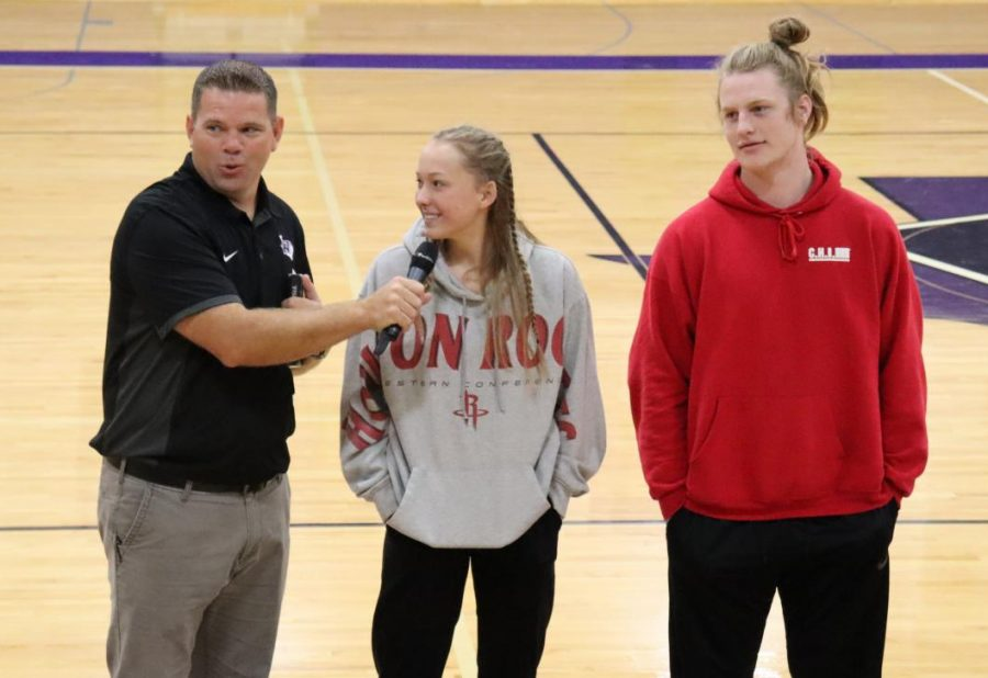 FAITH. Introducing the activity for FCA, Coach Keith Carey talks to juniors Bella Cantera and Andy Parker in front of the club.