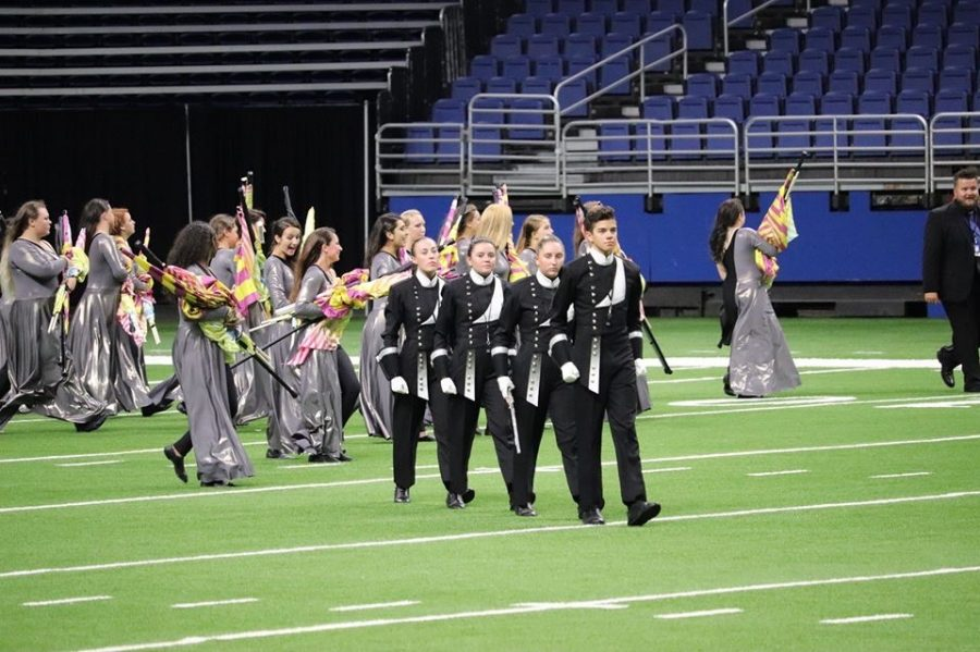 The+drum+majors+take+the+field+at+the+5A+State+Marching+Competition+in+San+Antonio.+The+band+finished+26th+in+the+state+with+their+show+Expanding+Spaces.+