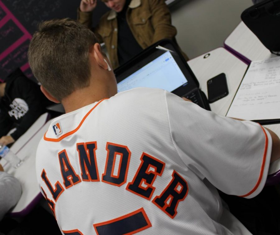 Sporting+his+Justin+Verlander+jersey%2C+junior+Heath+Truett+works+in+English+class.+In+support+of+the+team+in+the+World+Series%2C+students%2C+staff+members+and+administration+wore+Astros+shirts+and+jerseys+during+the+play-offs+and+World+Series.+