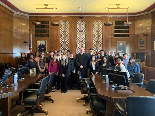 Members of the Justice League and sponsor Jessica Edwards toured a federal courthouse in Galveston. Pictured is Judge Jeff Brown with the group.