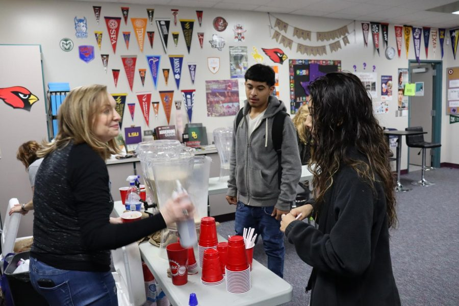 SWEET & SUCCESSFUL. Adding whip to the ice coffees, couselor Tricia Neumann serves coffee to seniors during GenTex college week.