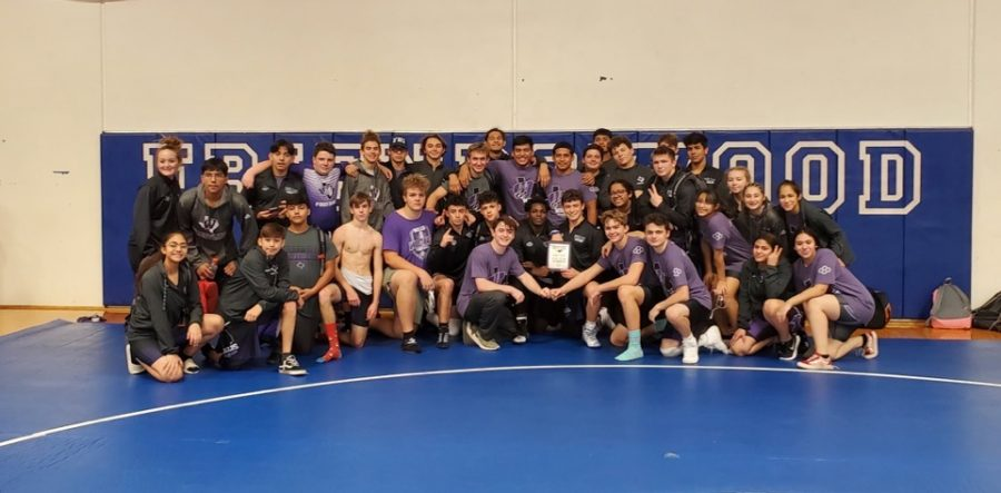 CHAMPIONS.+Celebrating+their+first+place+win+in+the+Friendswood+meet%2C+members+of+the+wrestling+team+take+a+team+pic.+The+boys+won+first+and+the+girls+earned+a+third+place+finish.+