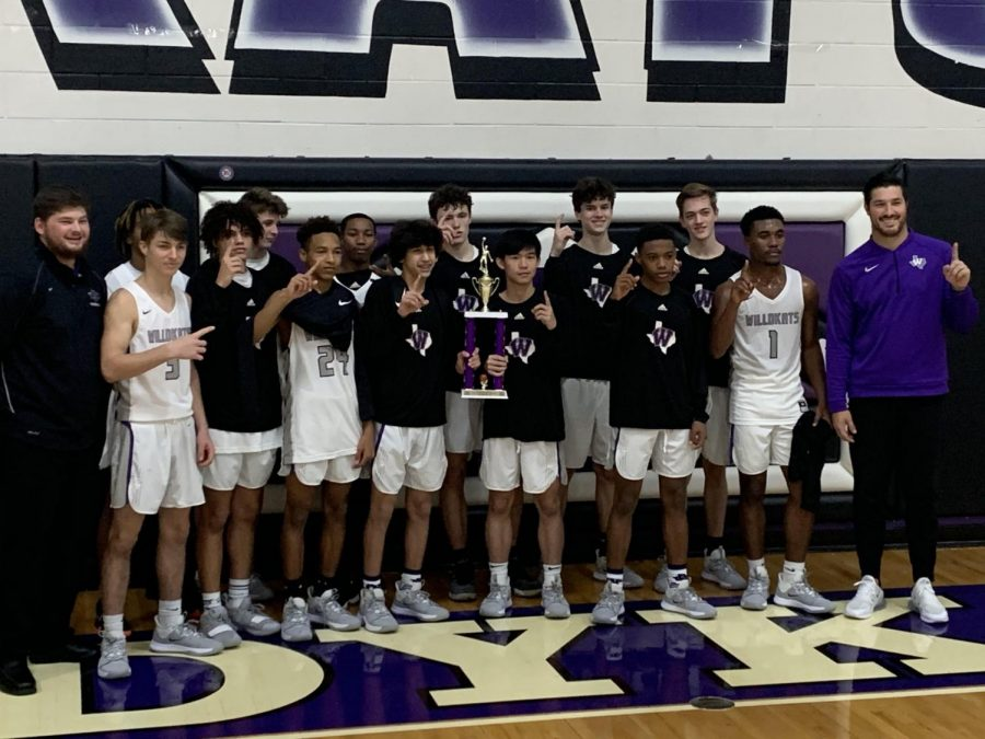 CHAMPIONS. Members of the JV team celebrate after winning their home tournament on Saturday.