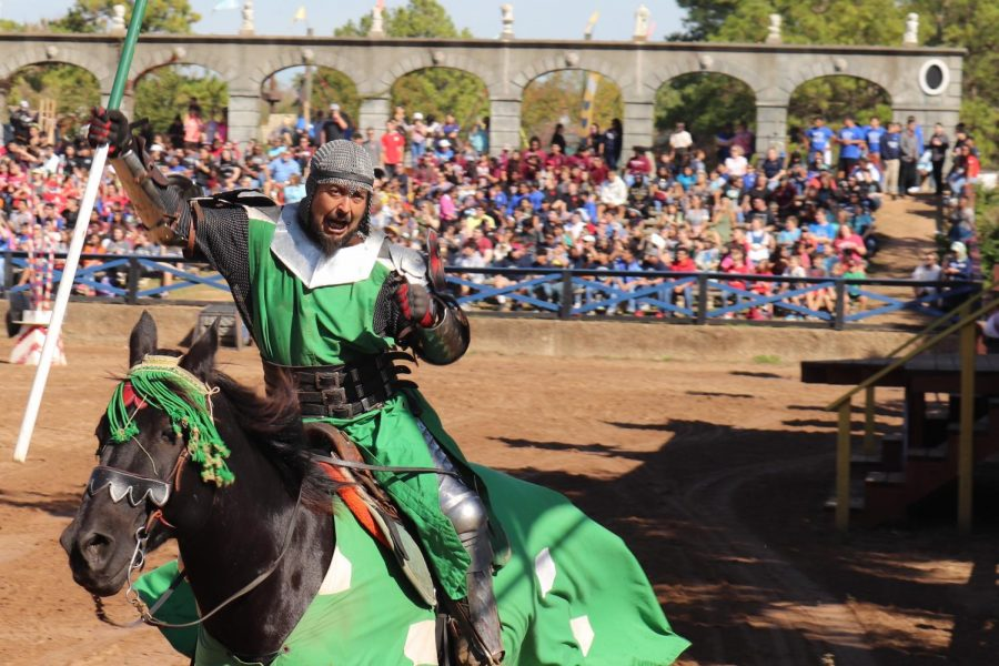 "THE EXCITEMENT OF BATTLE.  A performer at Ren Fest rallies the crowd before the jousting event. Jousting is a favorite event at the Ren Fest School Days. ""The event was exciting,"