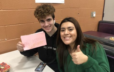 #WHSRAK. Presidents Council member senior Demaris Pelayo shares a RAK with a new friend, senior Brayden Sprat. As part of the council's RAK initiative, members are posting positive messages on social media and on post-its around the school.