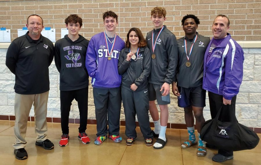 STATE BOUND. Coach Brian Thomas, junior Skylar Murillo, junior Cameron Collier, senior Anna Vargas, sophomore Aiden Collier, senior josh King and Coach Bryan Blake at the regional meet. Five wrestlers will represent the Wildkats this weekend at the Berry Center in Cypress.