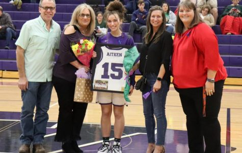 CLASS OF 2020. Before the game against Kingwood Park, the girls basketball team honored the class of 2020. Senior Allison Aitken is escorted by her parents and Coach Angel Kelley.