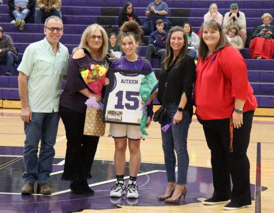 CLASS+OF+2020.+Before+the+game+against+Kingwood+Park%2C+the+girls+basketball+team+honored+the+class+of+2020.+Senior+Allison+Aitken+is+escorted+by+her+parents+and+Coach+Angel+Kelley.+