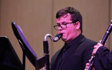 BEST OF THE BEST. During the opening ceremonies of the spring semester, junior Aaron Johnston performs during a fine arts showcase. Johnston is a member of the All-State and will attend the clinic and concert during TMEA this week in San Antonio.
