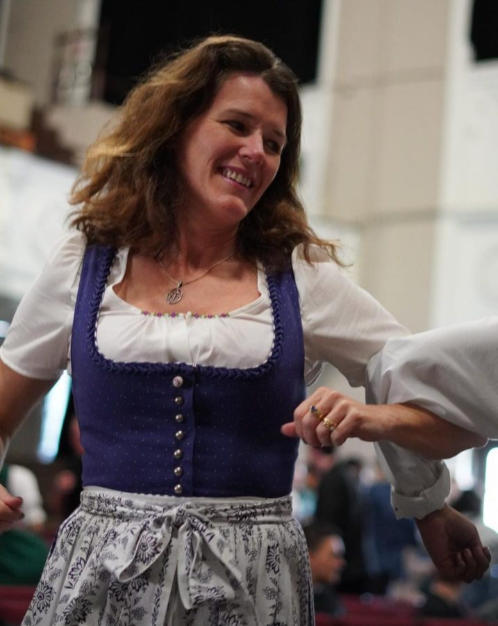 German teacher Lisa Parrott dances at GermanFest.  The festival is held each year at The Heights High School for students studying German.
