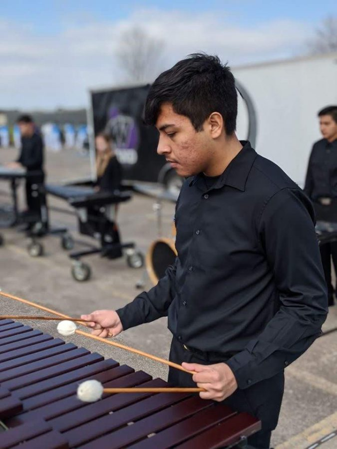 Member of the newly formed indoor percussion competition team warm up for a recent competition. This is the first year the band has competed in indoor percussion competitions.