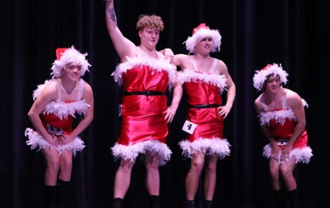 MEAN GIRLS ROCK. Holding their beginning pose, seniors Carson Jones, Collin Simmons, Garret Collum and Tanner Jones prepare for their talent performance of Jingle Bell Rock from the movie Mean girls.