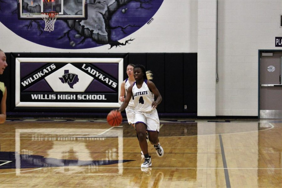 in the game against Montgomery, senior TeTe Hollis take the ball down the court. Hollis was named first team All- District