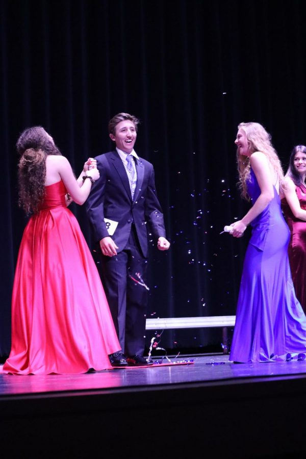 Confetti Reigns. Before finding out he was one of the top five finalists for Mr. Wildkat, senior Reed Hildenbrant struts down the runway with fellow seniors Delaney Jackson and Allison Aitken.