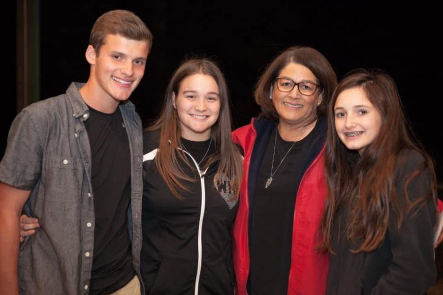 Writer senior Caleigh Nabors with Anne Chapa, senior Peyton Payne and Conroe High School senior David Chapa The photo was taken during Nabors's freshman year at Chapa's 40th anniversary party. The seniors were taught by Chapa for three years as part of the dual language program. Chapa is recovering from the coronavirus.