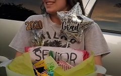 "With her present from a family friend, senior Cali Barlow accepts her gift of senior swag. Barlow was adopted by several families after her mom posted her information on the Facebook page Willis High School Adopt/Swap a Senior 2020.  ""The worst part is realizing that this chapter of my life is truly over,"" Barlow said. ""Being 'adopted' made me realize that you never really lose the people who mean the most to you. They're in your heart forever."""