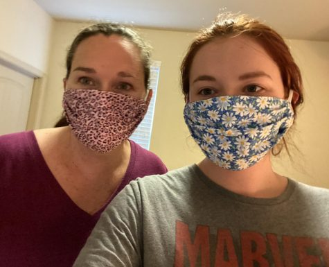 Sophomore Summer Rains and her mother Rhonda Adair model their new masks ordered from Carlis Closet. The CDC recommends wearing cloth face coverings in public settings where other social distancing measures are difficult to maintain (e.g., grocery stores and pharmacies), especially in areas of significant community-based transmission.