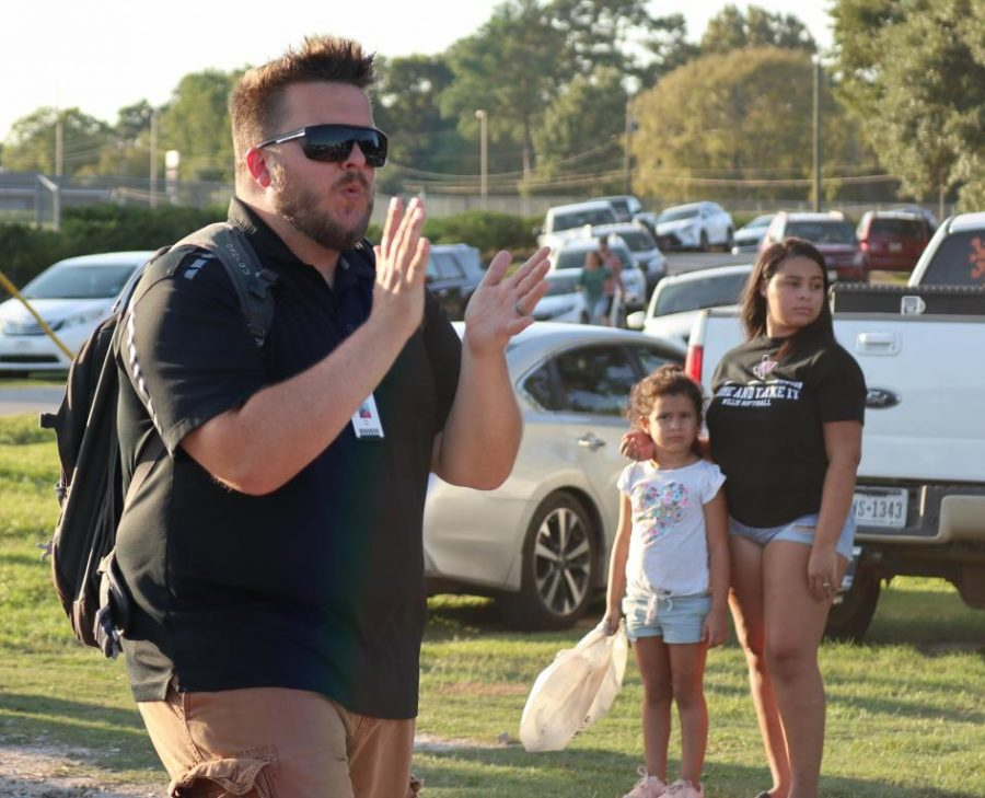 Assistant Band Director Andrew Hicks marches with the band during the homecoming parade. Hicks was recently named the head band director at Burnet High School.