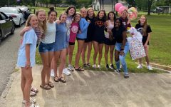 The volleyball team surprised Coach Megan Storms with a birthday parade on May 9th.