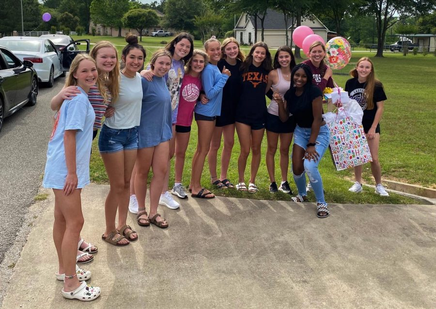 Volleyball team shows love for coach with birthday parade
