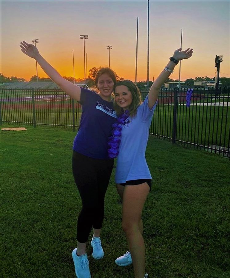 """GOOD MORNING CLASS OF '21. Seniors wake up bright and early to welcome the sun on their first day of school. Even though they're in the middle of a pandemic, seniors Jenna Day and Lindsay Davenport came together in small groups to take pictures at Yates Stadium to remember the exciting day. """"This morning, as the sun rose, it really set in that I am a senior now and even though I'm upset about the way it started, we, as a class, are doing our best to make the most out of it,"""" Davenport said."""