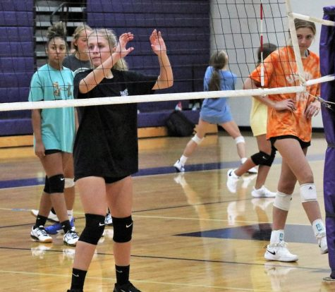 Working on skill drills, freshman Sophie Satterwhite practices with volleyball players from the varsity, jv and freshmen teams. Games for all teams have been postponed due to the coronavirus.
