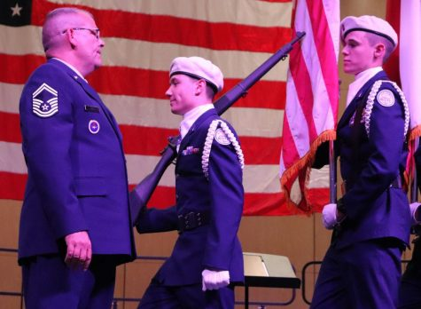 HONOR. Before the Veteran Day concert in 2019, SMSgt Christopher Bell instructs cadets. Bell was named Region 3 Aerospace Science Instructor.