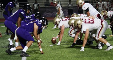 BACK UNDER THE FRIDAY NIGHT LIGHTS. Members of the Wildkat defense line up against Cy Falls in the scrimmage on September 18th. It was the first time the team played under the lights of Berton A. Yates Stadium this year.