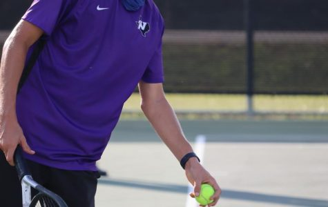 SERVE IT. SMASH IT. WIN IT. In a district match against College Park on Tuesday, sophomore Blaine Eckert prepares to serve. The tennis team plays Huntsville on Friday at home.
