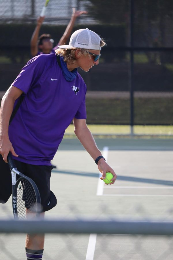 SERVE+IT.+SMASH+IT.+WIN+IT.+In+a+district+match+against+College+Park+on+Tuesday%2C+sophomore+Blaine+Eckert+prepares+to+serve.+The+tennis+team+plays+Huntsville+on+Friday+at+home.+