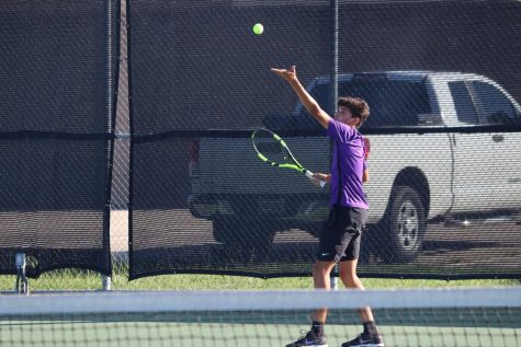SERVE IT UP. Junior Ryan Glasgow serves the ball. He played a tough match against Grand Oaks.