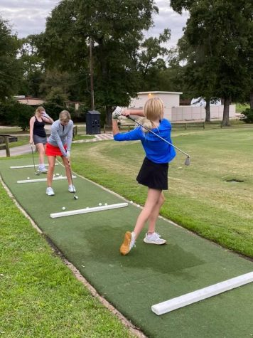 TRYING SOMETHING NEW. Members of the girls golf team practice at Panorama after school. They will have their first tournament of the season there today.