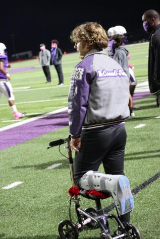 SIDELINED. After his injury during a scrimmage against Cy Woods, senior Patrick McConnell-Tasch watches in the action against College Station from the sideline.
