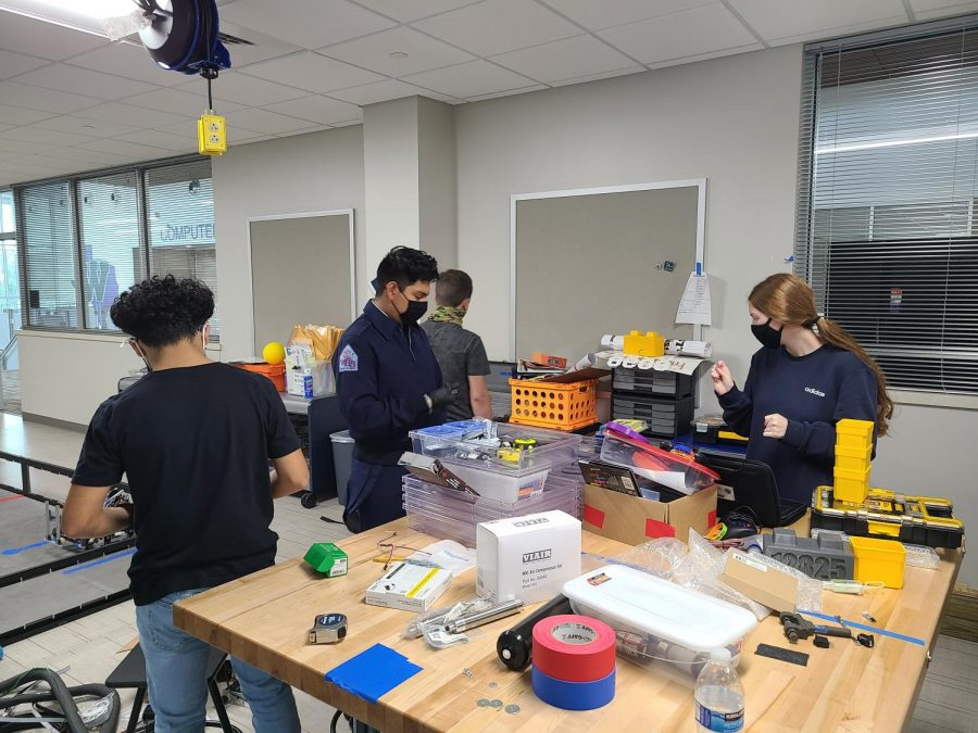 NUTS+AND+BOLTS.+Working+on+inventory%2C+sophomore+Javier+Banda%2C+Nathaniel+Navarrete%2C+Robert+Patteson+and+junior+Kendall+Cobb+are+sorting+through+all+the+equipment+in+the+robotics+room+before+they+start+building+their+bot.