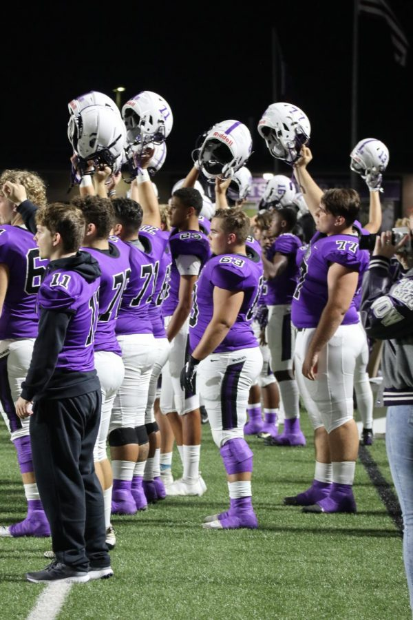 HELMETS+UP.+Traditions+like+players+raising+their+helmets%2C+the+Sweetheart+victory+line+and+the+school+song+at+the+end+of+the+game+have+made+the+year+of+COVID-19+a+little+more+normal.+