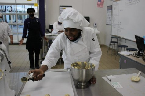 YUM. Junior Fantasia Lawrence scoops cookies onto the sheet in an advanced cullinary class.