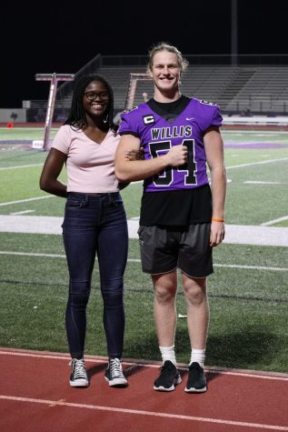 YEARBOOK BELLE AND BEAU. Seniors Sure Ibukun and Andy Parker pose for a picture while waiting for Fire Up the Kats to start.