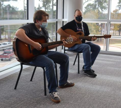 PRACTICE MAKES PERFECT.  Preparing for Willis Unlpugged on December 10, junior Douglas Fairbanks and director Ken Labonski practice upstairs in the PAC.  Choir and guitar have in-person concerts scheduled in December.