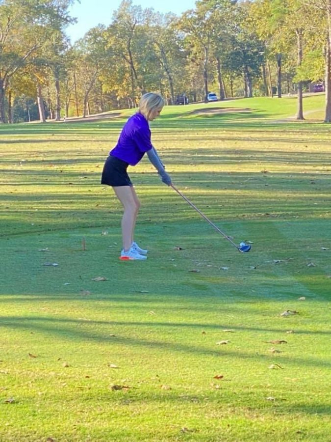FOURTH PLACE FINISH. Playing on home turf, junior Madi McCollum finishes strong on the course at Panorama. The girls' team finsihed first overall.