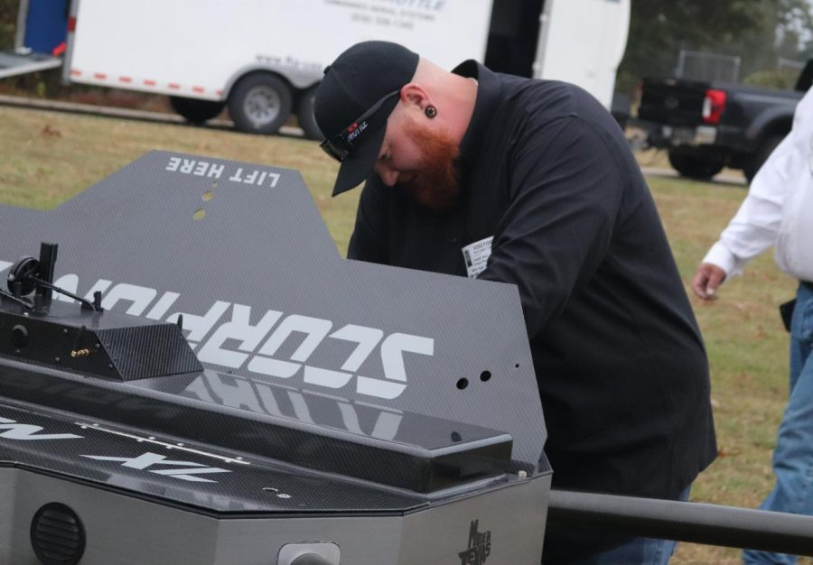 SCORPION XL. Getting the drone ready for action, employee of Full Throttle Aerial Joseph Anz works on calibration The Scorpion drone can carry up to 1000 pounds.