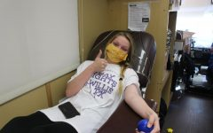 SAVING LIVES. Senior Kayla Lyons waits to give blood in the Gulf Coast Regional Blood Center Bus.