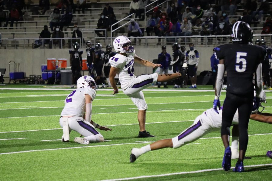 CHAMPION KICKER. During the play-off game against Spring Dekaney,  senior Christian Pavon sends the ball down field. Pavon recently was named champion of the Chris Sailer kicking camp.