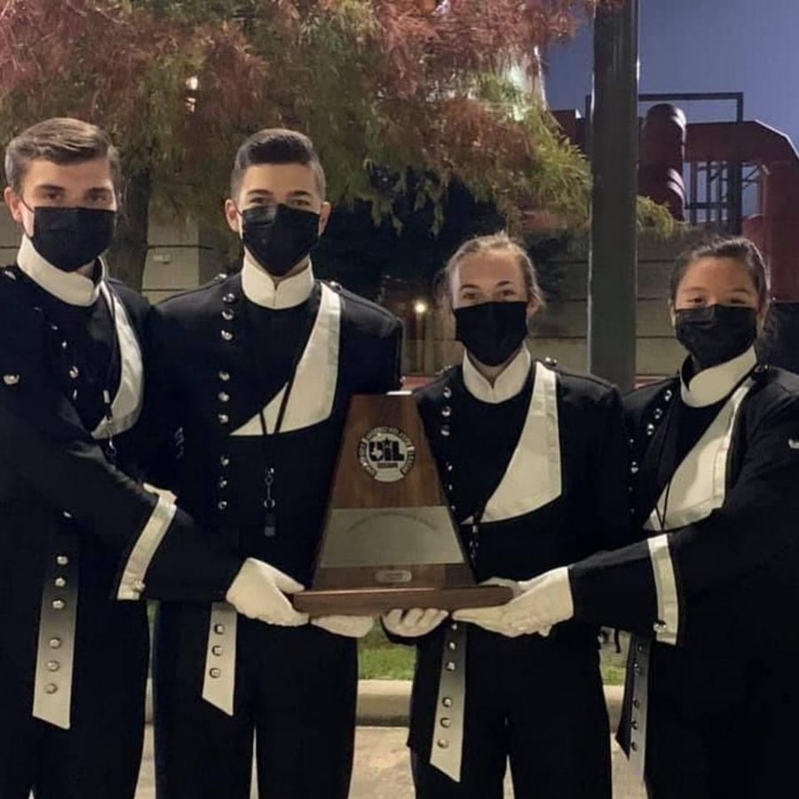 SWEEPSTAKES.+After+earning+ones+at+district+the+drum+majors%2C+seniors+Alex+Hopkins%2C+GianReo+Mire%2C+Melanie+Merkley+and+Stephanie+Orozco%2C+celebrate+with+a+picture+with+the+Sweepstakes+trophy.