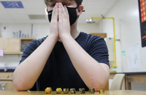With his dice lined up, freshman Zander Beetge is prepared for the game ahead. Science teacher started the Dungeons and Dice club for students interested in table top clubs like Dungeons and Dragons.