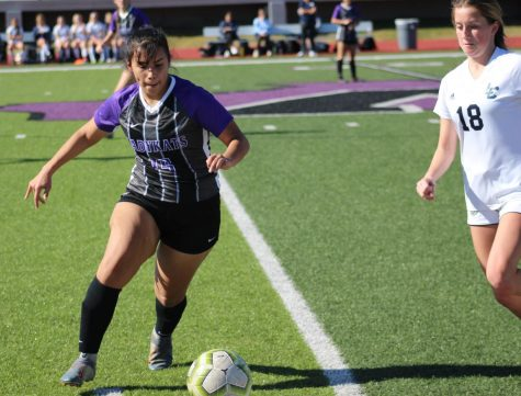 KAT CUP COMPETITION. Moving the ball, senior Alysha Martinez faces a Lake Creek player during the Kat Cup at Berton A Yates Stadium. The Kat Cup was a three day tournament the team hosts every year before district play begins,