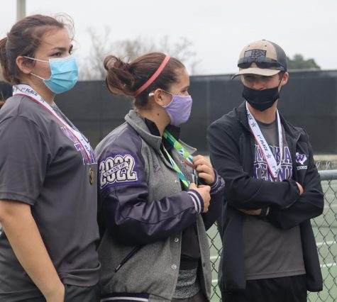 SPRING SEASON READY. At the fundraiser kicking off the spring season, sophomore Emma Baron, junior Zoe Picken and junior Brenan Mansker line up for medals after placing. The tennis team members have put in a lot of practice for the spring season tournaments.