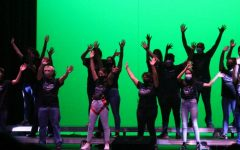 DEFYING GRAVITY.  During a performance for the 8th grade tour on Tuesday, cast members sing a song from Wicked. The musical will feature two large numbers and various solos from assorted musicals.
